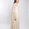Lace kaftan worn over strapless satin dress
