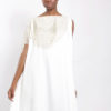 Claudette floyd white caftan with embellished detail at the neckline.