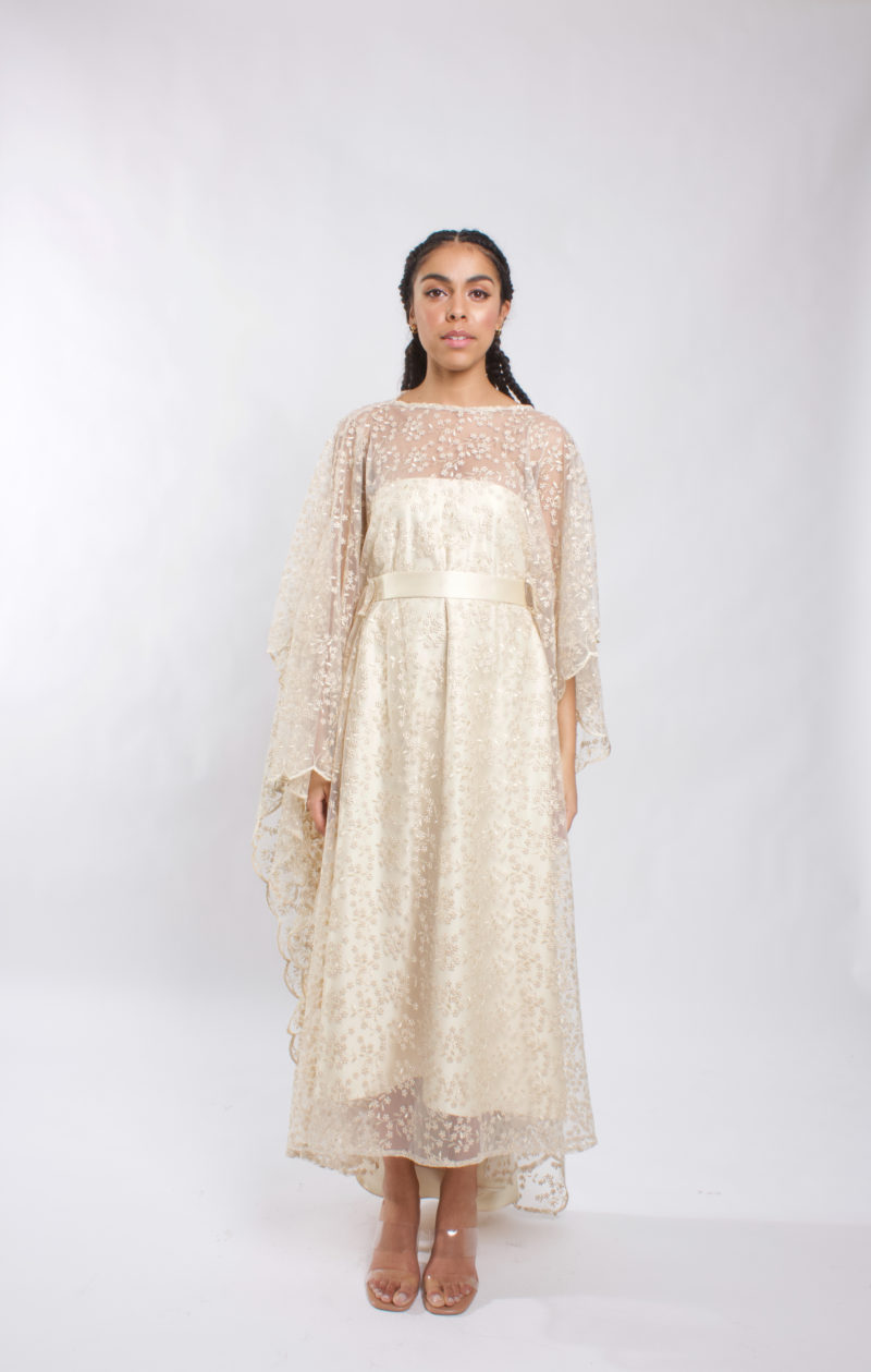 This caftan is made from lace tulle. It has a strapless under dress