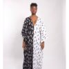 The is a colour block caftan . Floral black and white and white and black print.