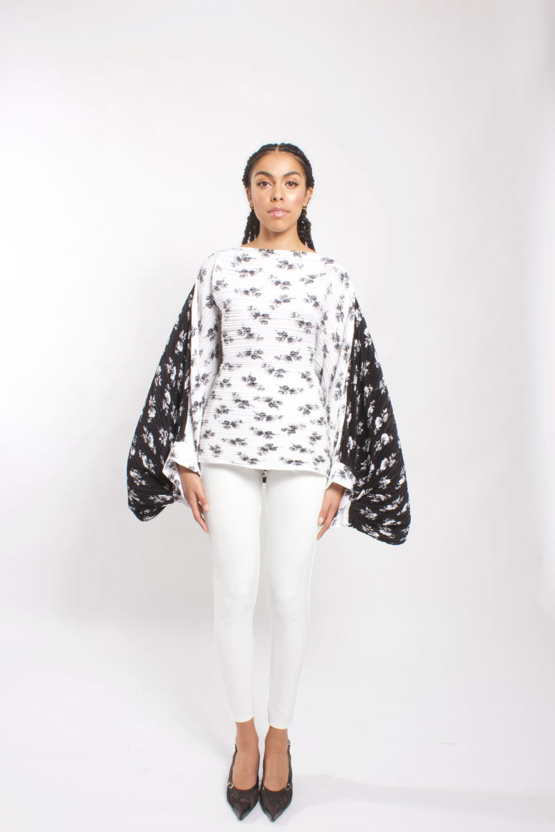 Boat neck top with balloon sleeve. Black and white floral top