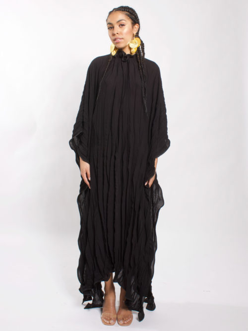 Pleated caftan with open detail on the legs